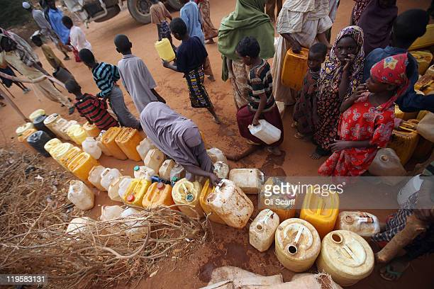 Water is delivered to Somalian refugees at the edge of the Ifo refugee camp which makes up part of the giant Dadaab refugee settlement on July 22...