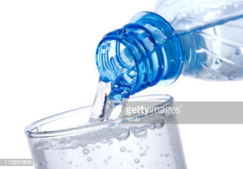 water is pouring into glass : Stock Photo
