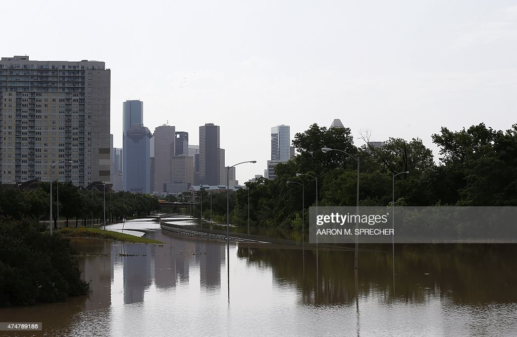 Water is seen along Memorial Drive in Houston Texas on May 26 2015 Heavy rains throught Texas put the city of Houston under massive amounts of water...