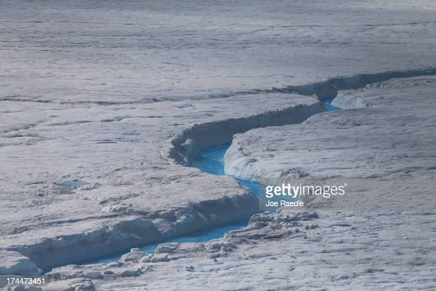 Water is seen on part of the glacial ice sheet that covers about 80 percent of the country is seen on July 17 2013 on the Glacial Ice Sheet Greenland...