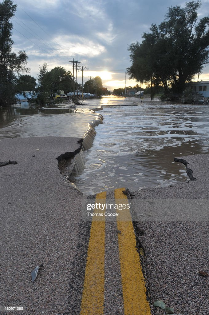 Water is shown receding from a heavily damaged road September 17, 2013 near Evans, Colorado. Even as flooding subsides, many in the hardest hit areas of the state remain stranded by washed out roads and rushing creeks and without water and power.