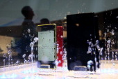Water is splashed on the Sony Xperia Z1 smartphone in the Sony booth at the 2014 International CES at the Las Vegas Convention Center on January 8...