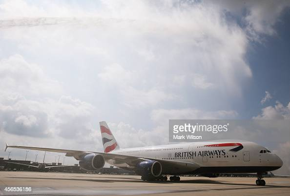 Water is sprayed from a fire truck to welcome British Airways' new super jumbo Airbus A380 as it taxies to its gate at Washington Dulles...
