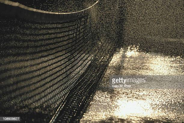 Water is sprayed onto the clay court and the net during the French Open Tennis Championship on 1st June 1997 at the Stade Roland Garros Stadium in...