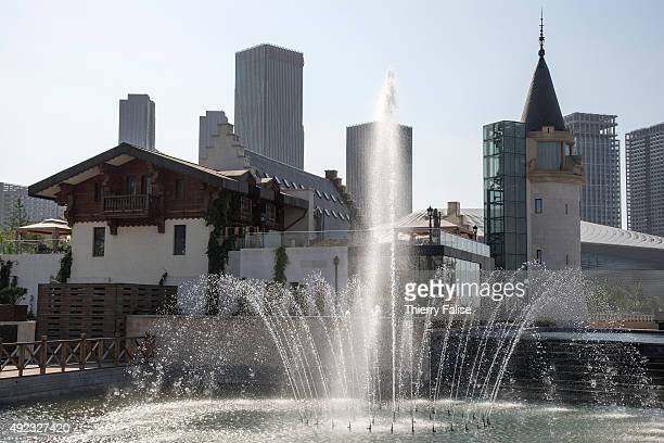 Water jets at Dalian's 'City of Water' with high rise buildings in the background The City of Water also dubbed Venice of the East or the Oriental...