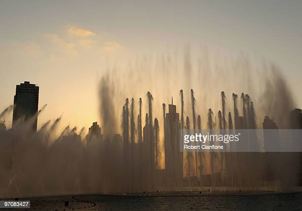 Water jets spray out of the The Dubai Fountain on February 25 2010 in Dubai United Arab Emirates Set on the 30acre Burj Dubai Lake the fountain...