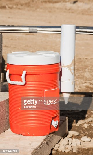 'water jug, orange plastic'