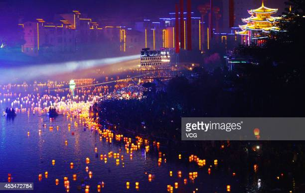 Water lanterns float on a river during Hungry Ghost Festival at Ziyuan County on August 9 2014 in Guilin Guangxi Zhuang Autonomous Region of China...