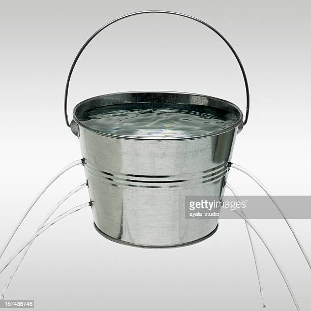 Water leaking from holes in bucket