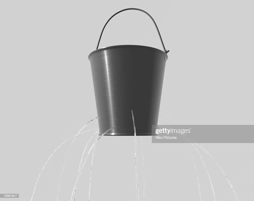 Water leaking from holes in bucket