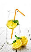 Water , lemon , bottle, white background