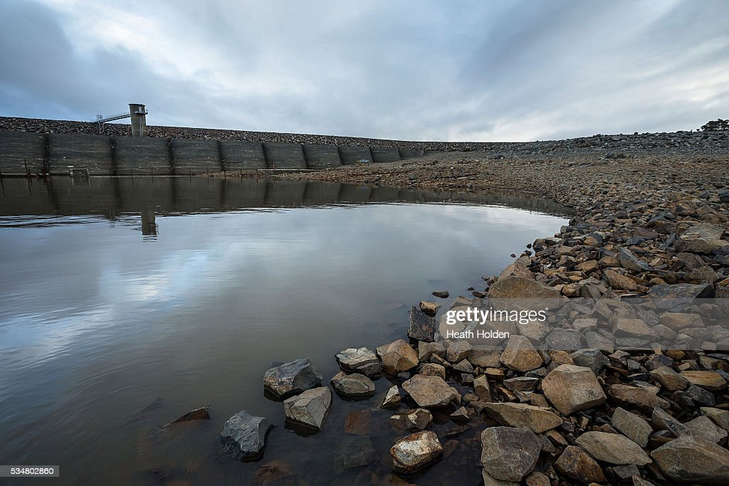 Water levels are slowly rising in Tasmania's hydro lakes as seen at the dam wall on May 28, 2016 in Great Lake, Australia. Several weeks of rain fall in the area has seen the lake rise about 1m after much needed water flow into the lake. Tasmania's dams are at record lows due to lower than average rainfall with storage levels of dams used to generate hydro power below 15 per cent for the first time.