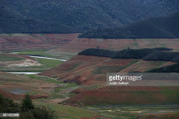 Water lines are visible in a nearly dry section of Lake McClure on March 24 2015 in Coulterville California More than 3000 residents in the Sierra...