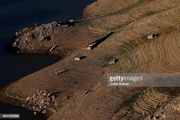 Water lines are visible in steep banks of Shasta Lake at Bridge Bay Resort on August 30 2014 in Redding California As the severe drought in...