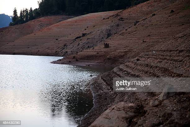 Water lines are visible on the steep banks of Shasta Lake at Bailey Cove August 31 2014 in Lakehead California As the severe drought in California...