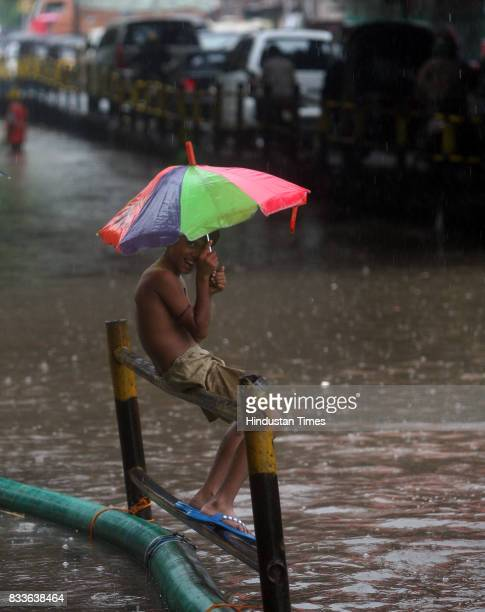 Water logging due to heavy rain at Milan subway Vile Parle on Saturday A boy enjoys the rain