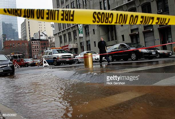 A water main break floods portions of Varick Street and creates cracks in the street just outside of the One Hudson Square building on March 16 2009...