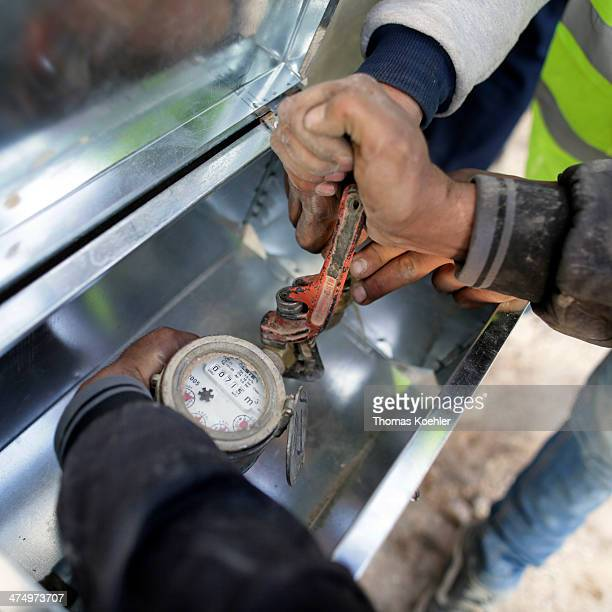 A water meter being fitted at a house in the town of Mafraq where German financial aid is helping to improve the quality and efficiency of the water...