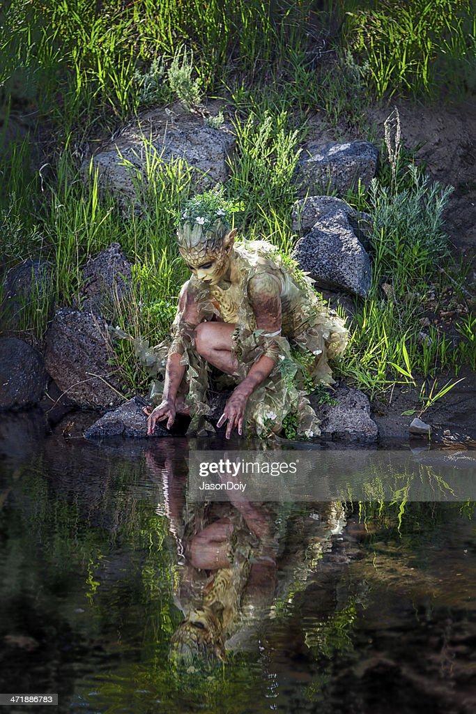 Water Nymph Gazing at Reflection : Stock Photo