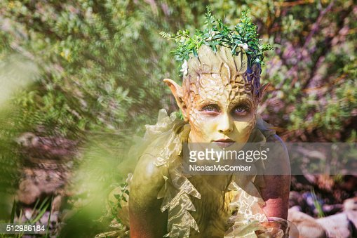 Water Nymph portrait emerging from bushes