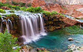 Beautiful waterfalls flowing in the desert heat providing life to the lush vegetation in the Grand Canyon near Havasu
