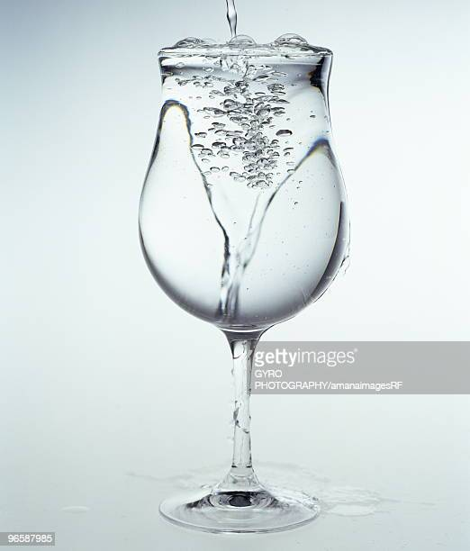 Water Overflowing from Wineglass