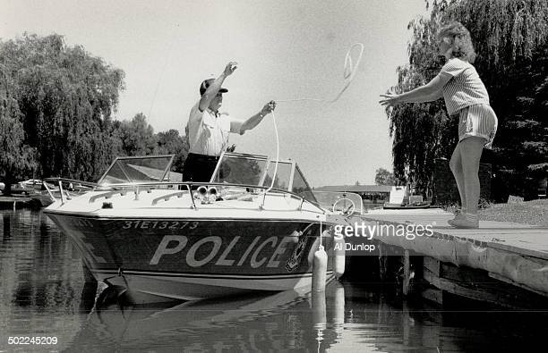 Water police Victoria Hezmer of Goreski's Summer Resort on Lake Scugog helps Constable Stewart Griffin a member of the Marine Unit of Durham Region...