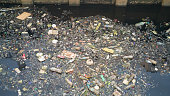 The Water pollution effects Dirty garbage in canal.