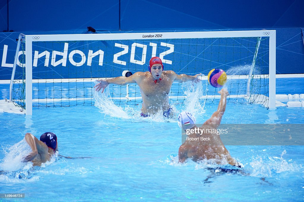 Hungary Norbert Hosnyanszky (6) in action, shot vs USA goalie Merrill Moses during Men's Preliminary Round - Group B game at Water Polo Arena. Robert Beck F458 )