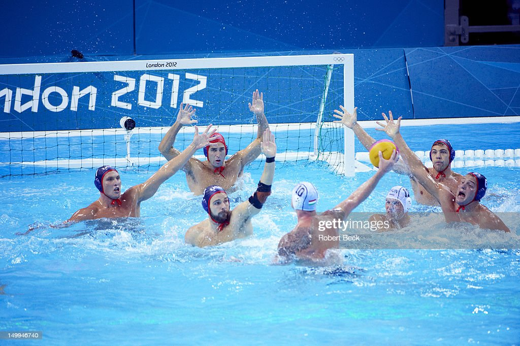 Hungary Peter Biros (10) in action, shot vs USA goalie Merrill Moses during Men's Preliminary Round - Group B game at Water Polo Arena. Robert Beck F37 )