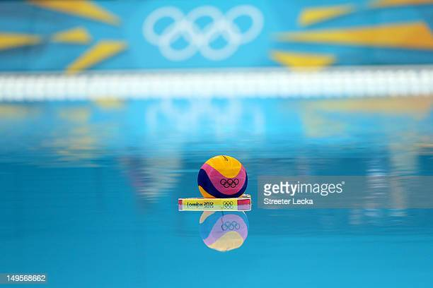 A water polo ball floats on the surface of the pool before the start of play on Day 4 of the London 2012 Olympic Games at Water Polo Arena on July 31...
