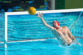 Front view of water polo goalie in defensive action