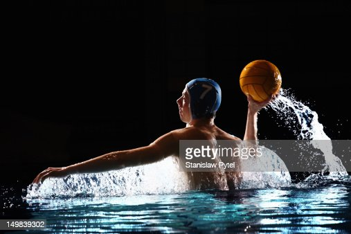 Water polo player throwing the ball : Stock Photo