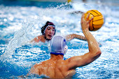 two water polo players during a game
