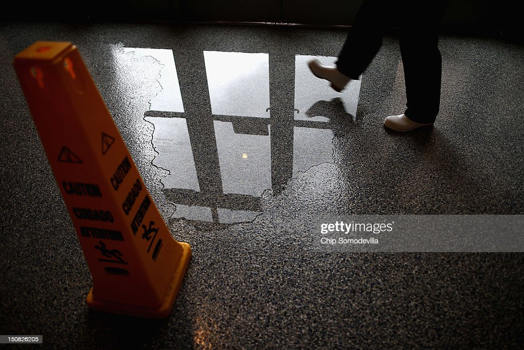 Water pools underneath doors on the third level of the Tampa Bay Times Forum on the abbreviated first day of the Republican National Convention August 27, 2012 in Tampa, Florida. Organizers decided to delay the start of the convention as the projected path of Tropical Storm Isaac' put the storm blowing past Tampa and into the Gulf of Mexico.