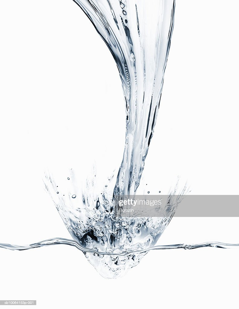 Water pouring and splashing on white background : Stock Photo