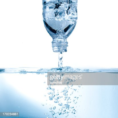 Water pouring from bottle : Stock Photo