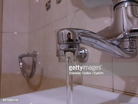 Water Pouring From Faucet Bathroom