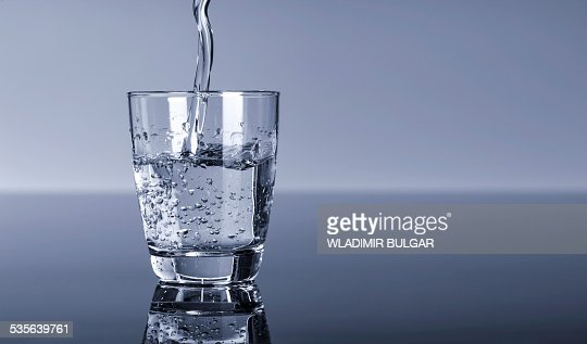Water pouring into a glass : ストックフォト