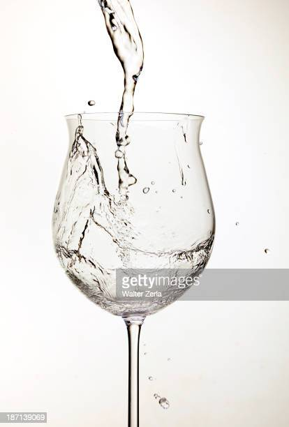 Water pouring into wine glass