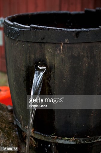 Water pouring out of a hole in a bucket