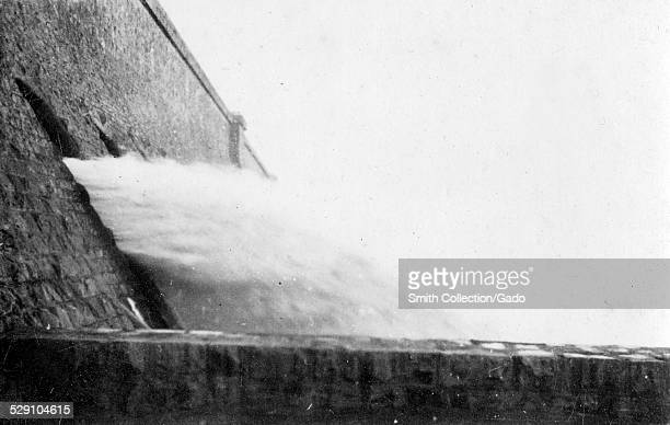 Water pouring through sluice gates at the Aswan Dam Aswan Egypt December 29 1918