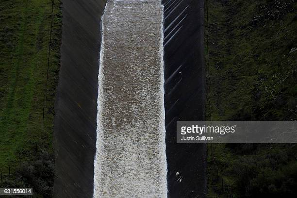 Water pours down a spillway out of Nicasio Reservoir on January 12 2017 in Nicasio California According to the US Drought Monitor 40 percent of...