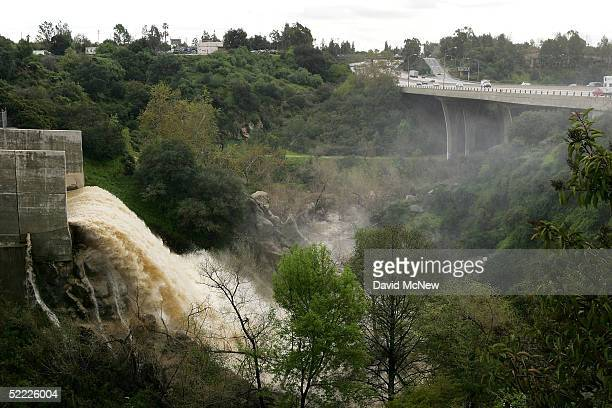 Water pours from the spillway at Devil's Gate Reservoir near the 210 freeway February 21 2005 in Pasadena California The Los Angeles metropolitan...