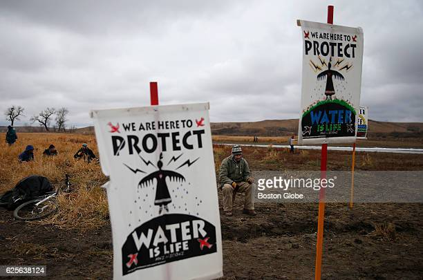 Water protectors protest as police line the hill at Standing Rock on Nov 24 during an ongoing dispute over the building of the Dakota Access Pipeline