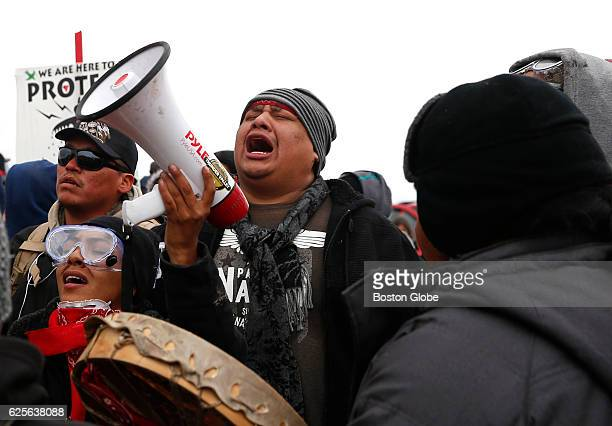 Water protectors sing across the river from Turtle Island as they protest at Standing Rock on Nov 24 during an ongoing dispute over the building of...
