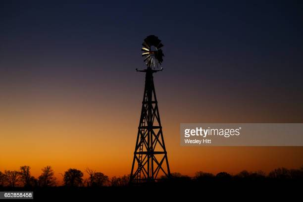 Water pumping windmill at sunrise