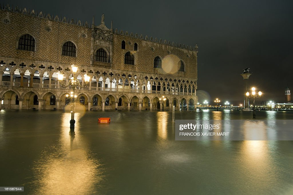 Water rises on St Mark's square during an acqua-alta (high-water) late on February 11, 2013 in Venice. The 'acqua alta', a convergence of high tides and a strong sirocco, reached 143 centimetres around midnight.