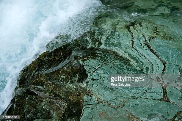 Water running over rocks, Glacier National Park, Montana, USA