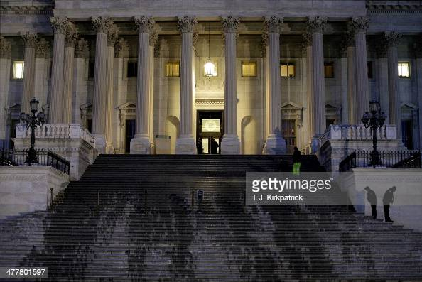 Water runs down the entrance to the US Senate chamber as workers clean the steps while Senate Democrats speak nonstop on the chamber floor about...